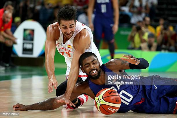 Ricky Rubio of Spain and Kyrie Irving of United States dive for the loose ball during the Men's Semifinal match on Day 14 of the Rio 2016 Olympic...