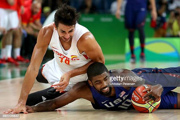 Ricky Rubio of Spain and Kyrie Irving of United States scramble for the loose ball during the Men's Semifinal match on Day 14 of the Rio 2016 Olympic...