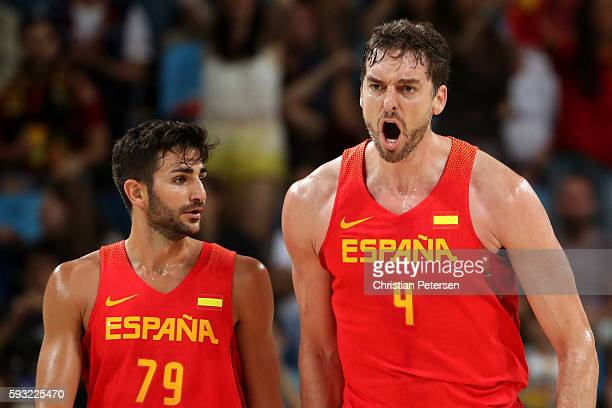 Ricky Rubio of Spain and Pau Gasol of Spain celebrate during the Men's Basketball Bronze medal game between Australia and Spain on Day 16 of the Rio...