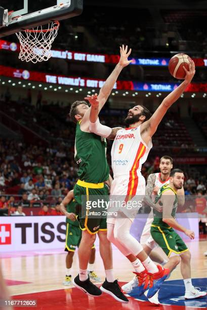 Ricky Rubio of Spain drives against Aron Baynes of Australia during the semifinals of 2019 FIBA World Cup match between Spain and Australia at...