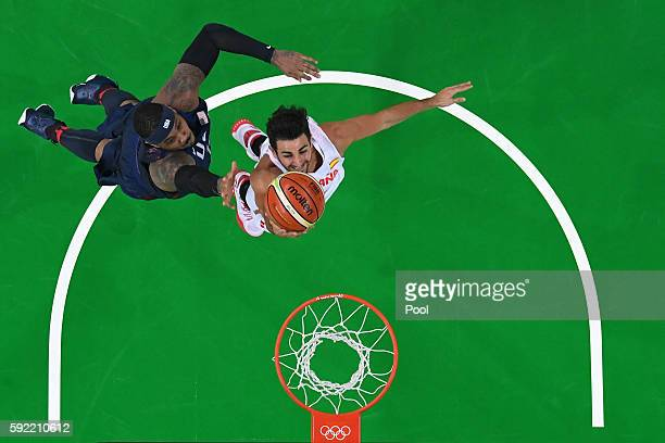 Ricky Rubio of Spain goes to the basket against Carmelo Anthony of United States during the Men's Semifinal match on Day 14 of the Rio 2016 Olympic...
