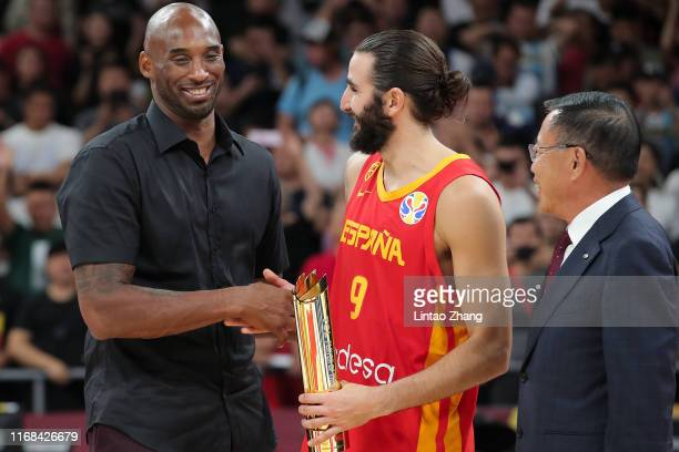 Ricky Rubio of Team Spain is awarded the FIBA World Cup tournament MVP with NBA Legends Kobe Bryant during FIBA World Cup 2019 final match between...