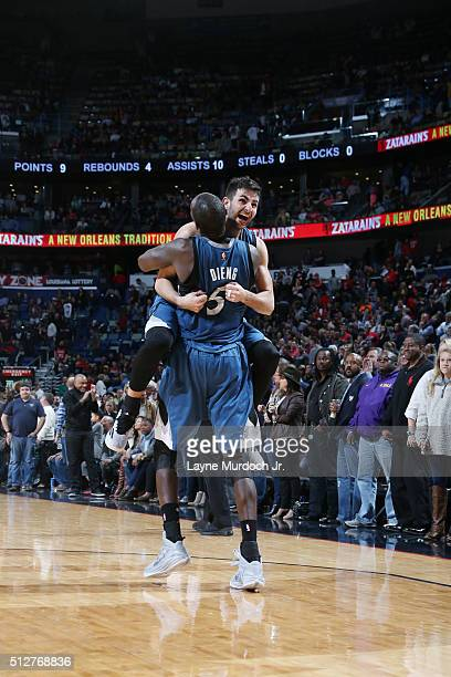 Ricky Rubio of the Minnesota Timberwolves and Gorgui Dieng of the Minnesota Timberwolves celebrate a victory against the New Orleans Pelicans after...