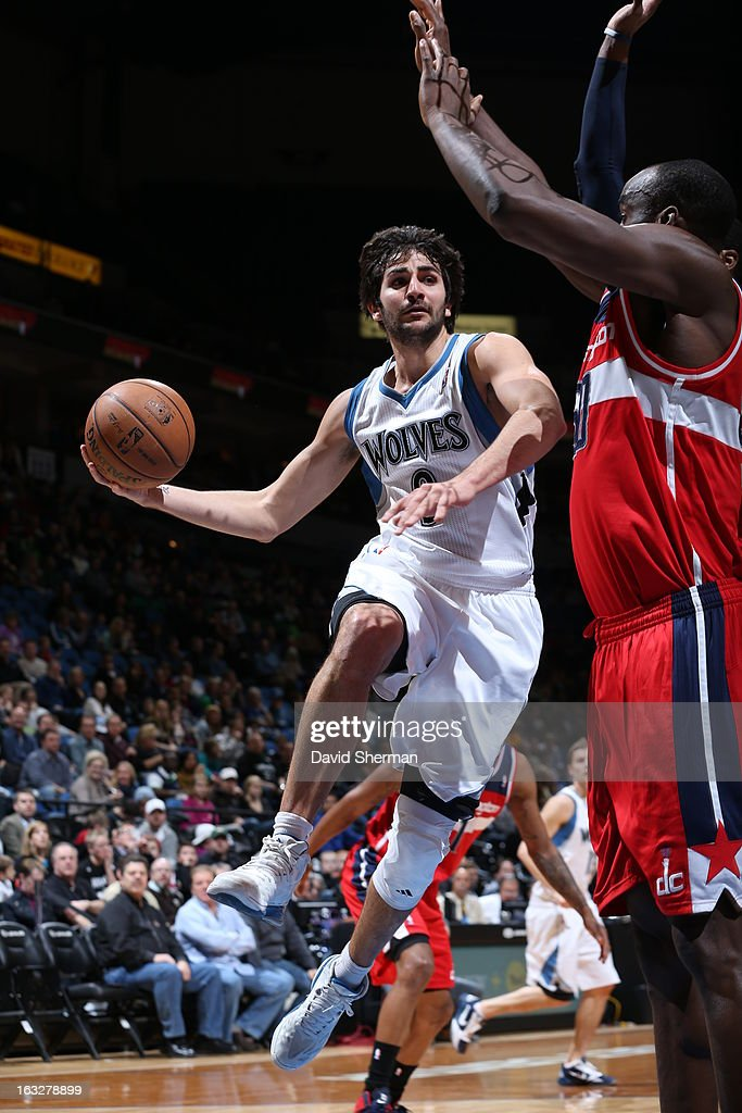 Ricky Rubio #9 of the Minnesota Timberwolves goes to the basket against Emeka Okafor #50 of the Washington Wizards on March 6, 2013 at Target Center in Minneapolis, Minnesota.