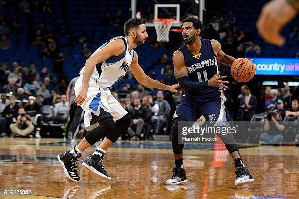 Ricky Rubio of the Minnesota Timberwolves guards against Mike Conley of the Memphis Grizzlies during the preseason game on October 19 2016 at Target...