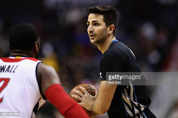 Ricky Rubio of the Minnesota Timberwolves looks to pass against John Wall of the Washington Wizards at Verizon Center on January 6 2017 in Washington...