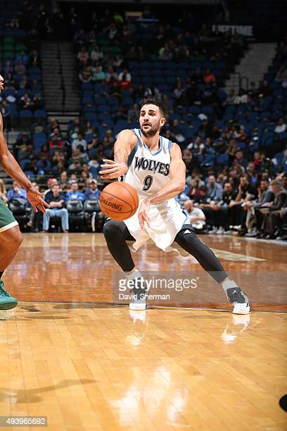 Ricky Rubio of the Minnesota Timberwolves passes the ball against the Milwaukee Bucks during a preseason game on October 23 2015 at Target Center in...