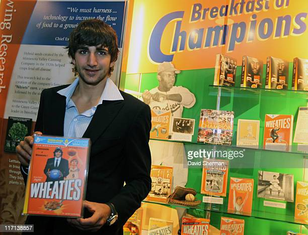 Ricky Rubio of the Minnesota Timberwolves poses for a picture with a mockup of a personalized Wheaties box at General Mills headquarters on June 23...