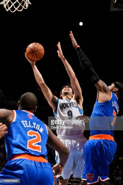 Ricky Rubio of the Minnesota Timberwolves shoots a layup against Carmelo Anthony of the New York Knicks at Target Center in Minneapolis Minnesota on...