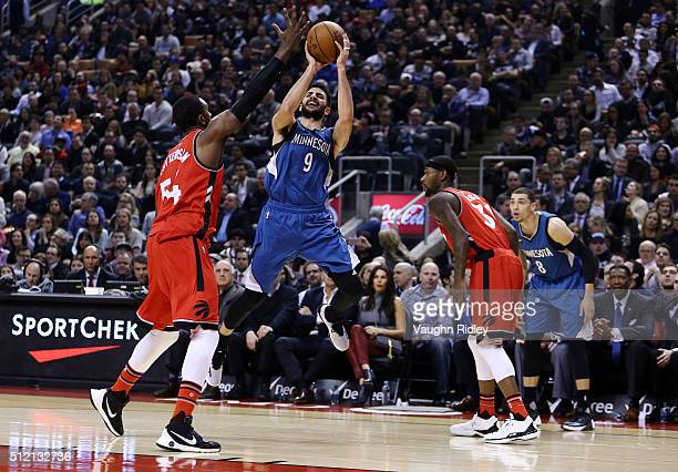 Ricky Rubio of the Minnesota Timberwolves shoots the ball as Patrick Patterson of the Toronto Raptors defends during the first half of an NBA game at...