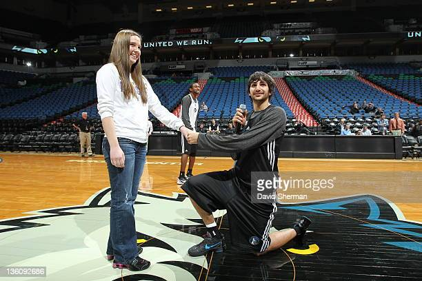 Ricky Rubio of the Minnesota Timberwolves sings happy birthday to a fan during an open team scrimmage on December 19, 2011 at Target Center in...