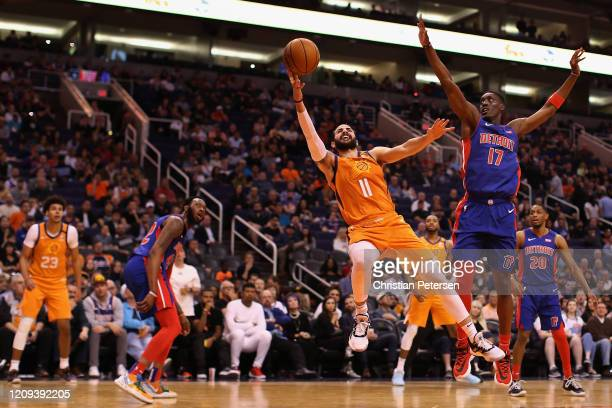 Ricky Rubio of the Phoenix Suns attempts a shot ahead of Tony Snell of the Detroit Pistons during the second half of the NBA game at Talking Stick...