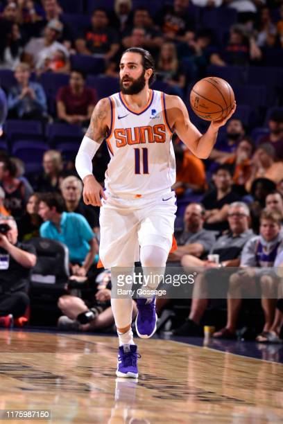 Ricky Rubio of the Phoenix Suns handles the ball against the Denver Nuggets during a preseason game on October 14 2019 at Talking Stick Resort Arena...