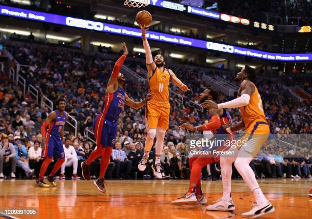 Ricky Rubio of the Phoenix Suns lays up a shot past Derrick Rose of the Detroit Pistons during the second half of the NBA game at Talking Stick...