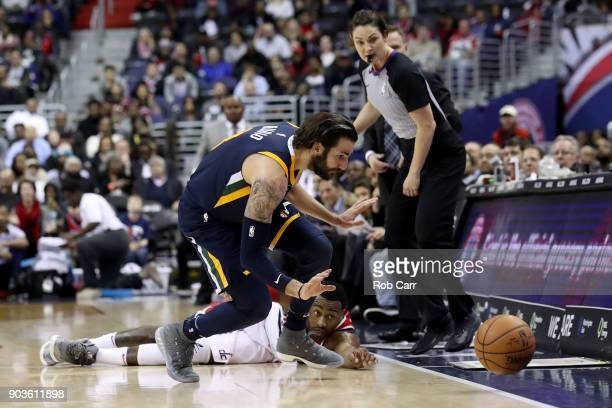 Ricky Rubio of the Utah Jazz and John Wall of the Washington Wizards go after a loose ball in the second half at Capital One Arena on January 10 2018...