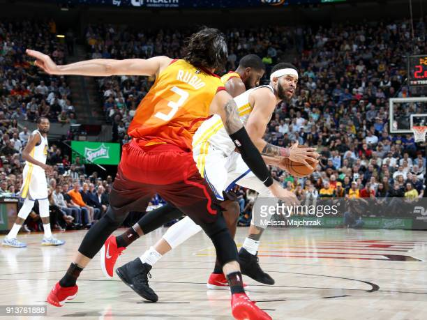 Ricky Rubio of the Utah Jazz covers JaVale McGee of the Golden State Warriors during the game between the two teams at vivintSmartHome Arena on...