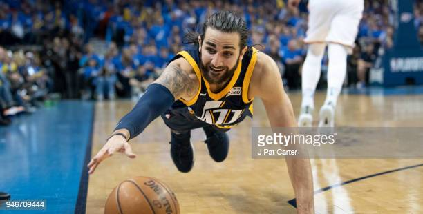 Ricky Rubio of the Utah Jazz dives for the ball after stealing it away from Carmelo Anthony of the Oklahoma City Thunder during the second half of...