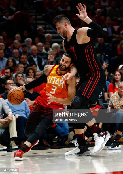 Ricky Rubio of the Utah Jazz drives against Jusuf Nurkic of the Portland Trail Blazers at Moda Center on April 11 2018 in Portland OregonNOTE TO USER...