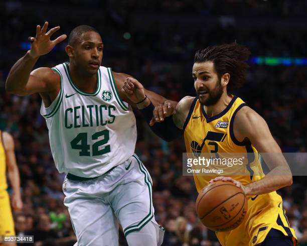 Ricky Rubio of the Utah Jazz drives to the basket on Al Horford of the Boston Celtics during the fourth quarter of the game at TD Garden on December...