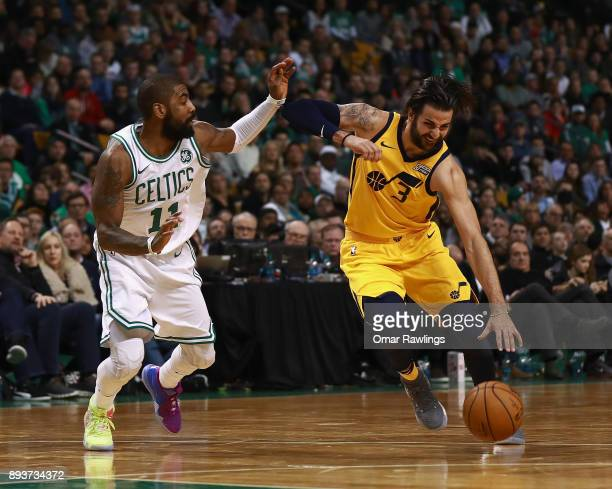 Ricky Rubio of the Utah Jazz drives to the basket on Kyrie Irving of the Boston Celtics during the fourth quarter of the game at TD Garden on...