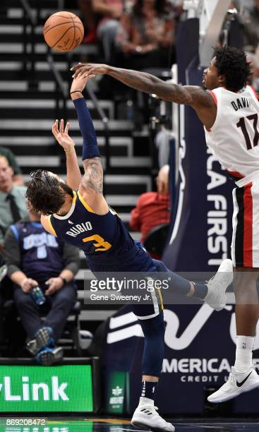 Ricky Rubio of the Utah Jazz is fouled by Ed Davis of the Portland Trail Blazers in the second half of the 112103 overtime win by the Jazz at Vivint...