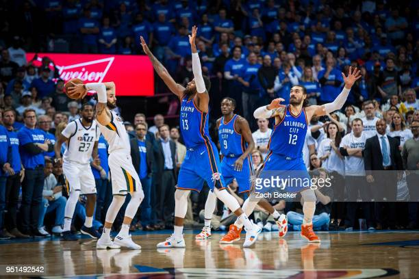 Ricky Rubio of the Utah Jazz looks to pass the ball while guarded by Paul George of the Oklahoma City Thunder in Game Five during Round One of the...