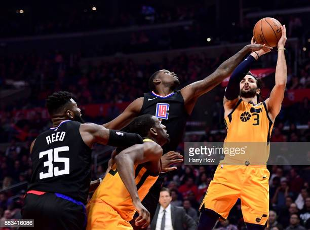 Ricky Rubio of the Utah Jazz shoots a fade away jumper over Jawun Evans of the LA Clippers during a 126107 win over the LA Clippers at Staples Center...