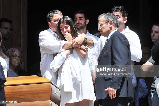Ricky Rubio's father Esteve Rubio and sister Laia Rubio attend the funeral for Tona Vives mother of the Minnesota Timberwolves basketball player...
