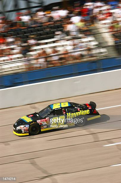Ricky Rudd driver of the Havoline Racing Ford Taurus in action during practice for the EA Sports 500 at Talladega Superspeedway on October 5 2002 in...