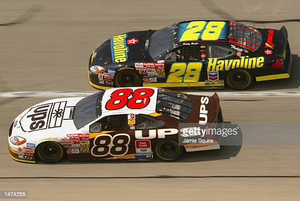 Ricky Rudd driver of the Havoline Racing Ford Taurus races alongside teammate Dale Jarrett during the NASCAR Winston Cup EA Sports 500 at Talladega...