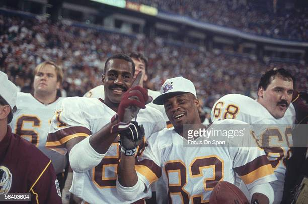"""Ricky Sanders and Art Monk of the Washington Redskins gesture """"#1"""" after defeating the Buffalo Bills for Super Bowl XXVI at the Metrodome on January..."""
