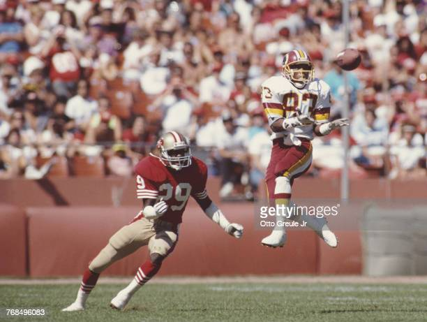Ricky Sanders Wide Receiver for the Washington Redskins jumps to make a running catch against Don Griffin of the San Francisco 49ers during the...