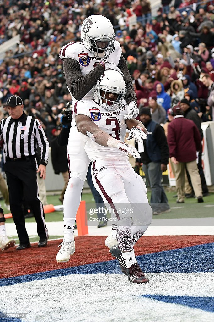 Ricky Seals-Jones #9 congratulates Trey Williams #3 of the Texas A&M Aggies following a third quarter touchdown against the West Virginia Mountaineers in the 56th annual Autozone Liberty Bowl at Liberty Bowl Memorial Stadium on December 29, 2014 in Memphis, Tennessee.