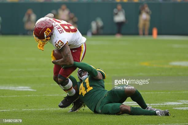Ricky Seals-Jones of the Washington Football Team is brought down by Henry Black of the Green Bay Packers during a game at Lambeau Field on October...