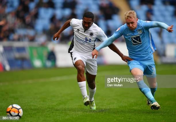 Ricky Shakes of Borehamwood is challenged by Jack Grimmer of Coventry City during the The Emirates FA Cup Second Round match between Coventry City...