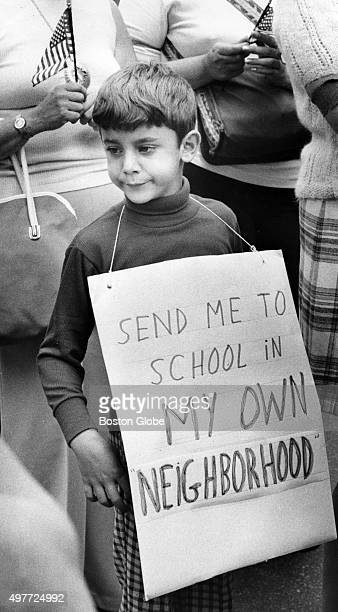 Ricky Shunilla of East Boston wears a sign that reads Send me to school in my own neighborhood during an antibusing demonstration on Sept 9 1974 The...