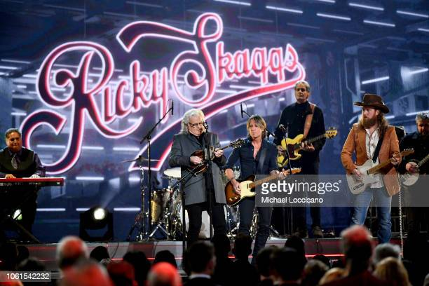Ricky Skaggs and Keith Urban perform onstage during the 52nd annual CMA Awards at the Bridgestone Arena on November 14 2018 in Nashville Tennessee
