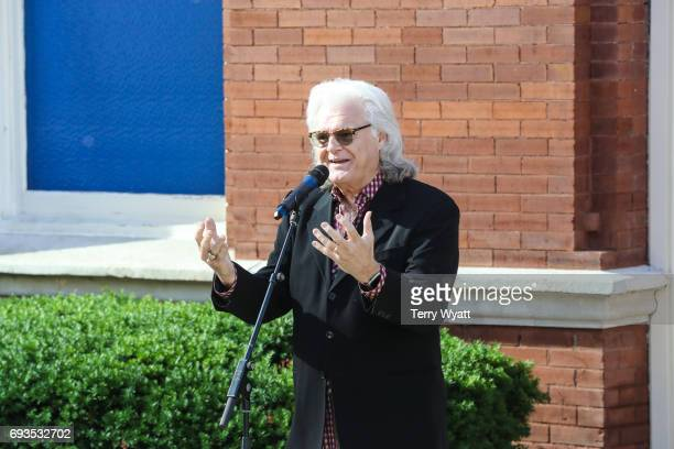 Ricky Skaggs speaks during the unveiling of statues of Little Jimmy Dickens and Bill Monroe at Ryman Auditorium on June 7, 2017 in Nashville,...