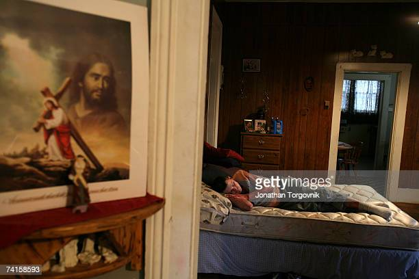 Ricky sleeping at his parents house where he lives on November 27, 2005 in Bowling Green, Kentucky. On Sunday morning Ricky , passed out and could...