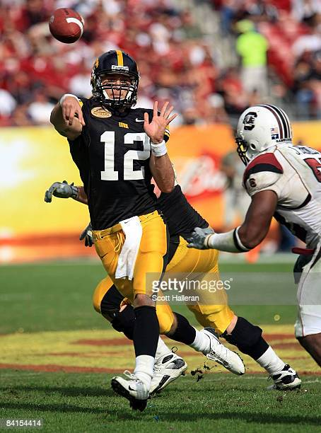 Ricky Stanzi of the Iowa Hawkeyes drops back to pass against the South Carolina Gamecocks during the Outback Bowl on January 1, 2009 at Raymond James...