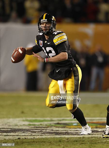 Ricky Stanzi of the Iowa Hawkeyes rolls out of the pocket against the Georgia Tech Yellow Jackets during the FedEx Orange Bowl at Land Shark Stadium...