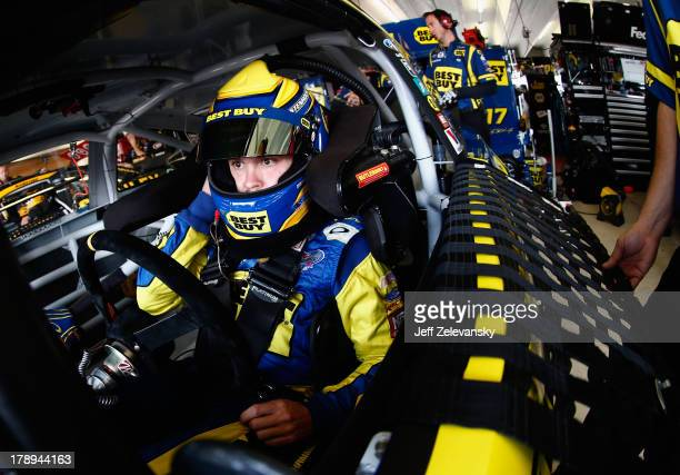 Ricky Stenhouse Jr driver of the Best Buy Ford sits in his car during practice for the NASCAR Sprint Cup Series AdvoCare 500 at Atlanta Motor...