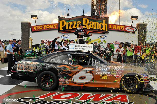 Ricky Stenhouse Jr driver of the Blackwell Angus Ford celebrates after winning the NASCAR Nationwide Series Inaugural John Deere Dealers 250 on May...
