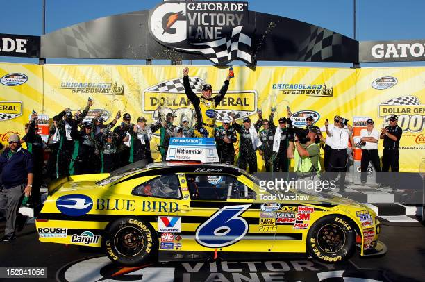 Ricky Stenhouse Jr., driver of the Blue Bird Ford, celebrates in Victory Lane after winning the NASCAR Nationwide Series Dollar 300 at Chicagoland...