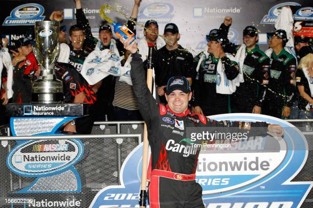 Ricky Stenhouse Jr driver of the Cargill Ford celebrates in Champions Victory Lane after winning the series championship and finishing sixth in the...