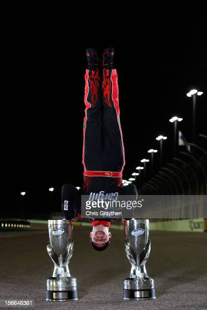 Ricky Stenhouse Jr., driver of the Cargill Ford, does a handstand on the track after winning back-to-back Nationwide series championships after...