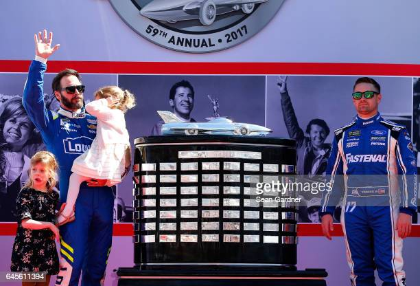 Ricky Stenhouse Jr driver of the Fastenal Ford and Jimmie Johnson driver of the Lowe's Chevrolet participates in the driver's intros with his...