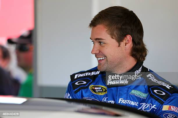 Ricky Stenhouse Jr driver of the Fastenal Ford stands in the garage area during practice for the 57th Annual Daytona 500 at Daytona International...