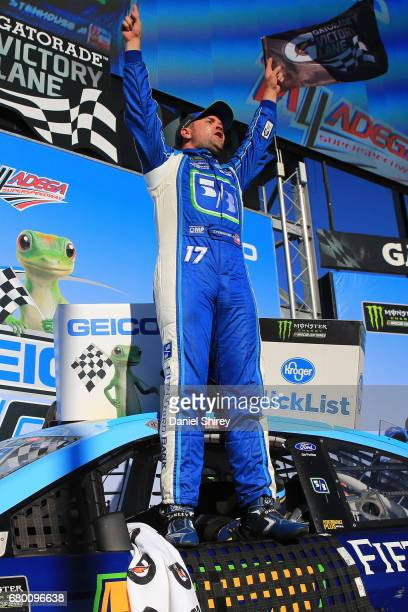 Ricky Stenhouse Jr driver of the Fifth Third Bank Ford celebrates in Victory Lane after winning the Monster Energy NASCAR Cup Series GEICO 500 at...