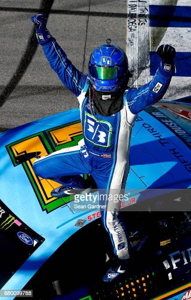 Ricky Stenhouse Jr driver of the Fifth Third Bank Ford celebrates wnning the Monster Energy NASCAR Cup Series GEICO 500 at Talladega Superspeedway on...